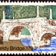 "UNITED KINGDOM - CIRCA 1968: A stamp printed in United Kingdom from the ""British Bridges"" issue shows Aberfeldy Bridge, circa 1968. — Stock Photo #25602759"