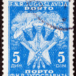 YUGOSLAVIA - CIRCA 1952: A stamp printed in Yugoslavia shows 5 Torches and Star, the Coat of Arms of Yugoslavia, circa 1952. - Stock Photo