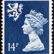 UNITED KINGDOM - CIRCA 1971: A stamp printed in Scotland shows Queen Elizabeth II and Royal Arms of Scotland, circa 1971. - Stock Photo
