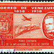 VENEZUELA - CIRCA 1959: A stamp printed in Venezuela issued for the centenary of first Venezuelan stamps shows stamp of 1859, Don Miguel Herrera, mail train and Douglas DC-6 airliner, circa 1959.  — Stock Photo