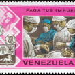 VENEZUELA - CIRCA 1974: A stamp printed in Venezuela from the Pay Your Taxes Campaign issue shows Surgical team in operating theatre, circa 1974.  — Stock Photo