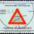"TURKEY - CIRC1969: stamp printed in Turkey from ""Turkish Economy"" issue shows Road sign and graph composition (Highways) , circ1969. — Stock Photo #25604603"