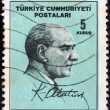 Stock Photo: TURKEY - CIRCA 1965: A stamp printed in Turkey shows Kemal Ataturk and signature, circa 1965.