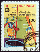 "INDIA - CIRCA 1982: A stamp printed in India from the ""9th Asian Games, New Delhi"" 5th issue shows Arjuna shooting arrow at fish (archery), circa 1982. — Stock Photo"