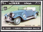 "AJMAN EMIRATE - CIRCA 1970: A stamp printed in United Arab Emirates from the ""65th Anniversary of the Hubert V. Herkomer Rallye"" issue shows Packard-833 of 1930, circa 1970. — Stock Photo"