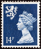 UNITED KINGDOM - CIRCA 1971: A stamp printed in Scotland shows Queen Elizabeth II and Royal Arms of Scotland, circa 1971. — Stock Photo