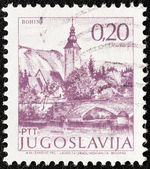 "YUGOSLAVIA - CIRCA 1971: A stamp printed in Yugoslavia from the ""Tourism"" issue shows Bohinj, Slovenia, circa 1971. — Stock Photo"
