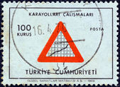"TURKEY - CIRCA 1969: A stamp printed in Turkey from the ""Turkish Economy"" issue shows Road sign and graph composition (Highways) , circa 1969. — Stock Photo"