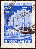 ARGENTINA - CIRCA 1954: A stamp printed in Argentina shows an industry and cogwheel, circa 1954. — Foto de Stock
