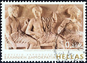 "GREECE - CIRCA 2006: A stamp printed in Greece from the ""Greek Museums"" issue shows gods Poseidon, Apollo and Artemis, East Parthenon Pediment (The Acropolis Museum), circa 2006. — Stock Photo"