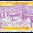 GUADELOUPE - CIRCA 1928: A stamp printed in France shows Sugar Refinery, circa 1928. — Stock Photo