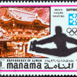 "MANAMA DEPENDENCY - CIRCA 1971: A stamp printed in United Arab Emirates from the ""1972 Winter Olympic Games - Sapporo, Japan"" issue shows Men's figure skating, circa 1971. — Stock Photo #25888075"