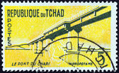 CHAD - CIRCA 1961: A stamp printed in Chad shows Chari Bridge and Hippopotamus, circa 1961. — Foto Stock