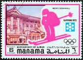 "MANAMA DEPENDENCY - CIRCA 1971: A stamp printed in United Arab Emirates from the ""1972 Winter Olympic Games - Sapporo, Japan"" issue shows Men's downhill, circa 1971. — Stock Photo"