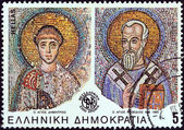 "GREECE - CIRCA 1985: A stamp printed in Greece from the ""2300th anniversary of Thessaloniki city"" issue shows mosaics of Saints Demetrius and Methodius, circa 1985. — Stock Photo"