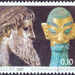 Stock Photo: GREECE - CIRC2007: stamp printed in Greece issued for Cultural Year of Greece in Chinshows Zeus of Artemision statue and bronze head sculpture with golden mask, Shang dynasty, circ2007.