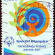 "GREECE - CIRCA 2011: A stamp printed in Greece from the ""Special Olympics World Games Athens 2011"" issue shows emblem, circa 2011. — Stock Photo"