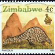 "ZIMBABWE - CIRC1990: stamp printed in Zimbabwe from ""Wildlife"" issue shows pangolin, circ1990. — Stock Photo #26828953"