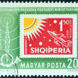 "HUNGARY - CIRCA 1963: A stamp printed in Hungary from the ""Organization of Socialist Countries Postal Administrations Conference, Budapest"" issue shows an Albanian stamp of 1962, circa 1963. — Stock Photo"