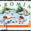 "ROMANIA - CIRCA 1960: A stamp printed in Romania from the ""Village Children's Games"" issue shows children swimming, circa 1960. — Stock Photo"