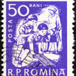Stock Photo: ROMANI- CIRC1960: stamp printed in Romanishows children at play, circ1960.