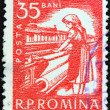 Stock Photo: ROMANI- CIRC1960: stamp printed in Romanishows textile worker, circ1960.