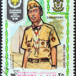 "MANAMA DEPENDENCY - CIRCA 1971: A stamp printed in United Arab Emirates from the ""13th World Jamboree of the Boy Scouts in Japan"" issue shows boy scout from Singapore, circa 1971. — Stock Photo #26829639"