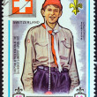 "AJMAN EMIRATE - CIRCA 1971: A stamp printed in United Arab Emirates from the ""13th World Boy Scout Jamboree - Japan"" issue shows boy scout from Switzerland, circa 1971. — Stock Photo"