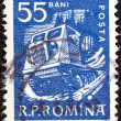 Stock Photo: ROMANI- CIRC1960: stamp printed in Romanishows timber tractor, circ1960.