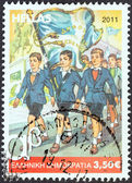"""GREECE - CIRCA 2011: A stamp printed in Greece from the """"Primary School Reading Books"""" issue shows cover of the 5th grade reading book, circa 2011. — Stock Photo"""