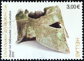 "GREECE - CIRCA 2010: A stamp printed in Greece from the ""2500th anniversary of Battle of Marathon"" issue shows bronze Corinthian helmet of Miltiades, circa 2010. — Stock Photo"