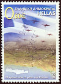GREECE - CIRCA 2011: A stamp printed in Greece issued for the 70th anniversary of the Battle of Crete shows Greek flag and airplanes over Crete, circa 2011. — Stock Photo