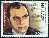 "GREECE - CIRCA 2010: A stamp printed in Greece from the ""Folk Music"" issue shows singer Stelios Kazantzidis (1931-2001), circa 2010. — Stock Photo"