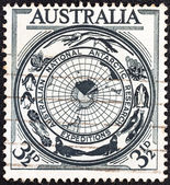 "AUSTRALIA - CIRCA 1954: A stamp printed in Australia from the ""Australian Antarctic Research"" issue shows territory badge, circa 1954. — Stock Photo"