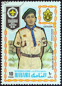 "MANAMA DEPENDENCY - CIRCA 1971: A stamp printed in United Arab Emirates from the ""13th World Jamboree of the Boy Scouts in Japan"" issue shows boy scout from Ceylon (Sri Lanka ), circa 1971. — Stock Photo"