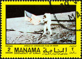 "MANAMA DEPENDENCY - CIRCA 1970: A stamp printed in United Arab Emirates from the ""Space exploration"" issue shows U.S. flag on the moon, circa 1970. — Stock Photo"