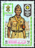 "MANAMA DEPENDENCY - CIRCA 1971: A stamp printed in United Arab Emirates from the ""13th World Jamboree of the Boy Scouts in Japan"" issue shows boy scout from Thailand, circa 1971. — Stock Photo"