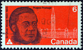 CANADA - CIRCA 1970: A stamp printed in Canada issued for the 150th anniversary of his birth shows statesman Sir Oliver Mowat and Parliament, circa 1970. — Stock Photo