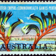 Stock Photo: AUSTRALI- CIRC1962: stamp printed in Australiissued for British Empire and Commonwealth Games, Perth shows Perth and Kangaroo Paw plant, circ1962.