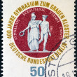 Stock Photo: GERMANY - CIRC1974: stamp printed in Germany from issued for 400th anniversary of Berlin Grauen Kloster gymnasium shows school seal (Athenand Hermes), circ1974.