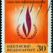 GERMANY - CIRCA 1968: A stamp printed in Germany issued for the Human Rights Year shows Human Rights Emblem, circa 1968. — Stock Photo