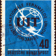 GERMANY - CIRCA 1965: A stamp printed in Germany issued for the Centenary of I.T.U. shows I.T.U. Emblem, circa 1965. — Stock Photo