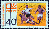 "GERMANY - CIRCA 1974: A stamp printed in Germany from the ""World Cup Football Championship"" issue shows midfield melee, circa 1974. — Stock Photo"