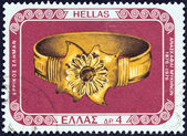 "GREECE - CIRCA 1976: A stamp printed in Greece from the ""100 years from Mycenae excavations"" issue shows gold bracelet, circa 1976. — Stock Photo"
