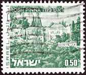 "ISRAEL - CIRCA 1971: A stamp printed in Israel from the ""Landscapes"" issue shows Rosh Pinna town, circa 1971. — Stock Photo"