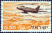 "ISRAEL - CIRCA 1967: A stamp printed in Israel from the ""Independence Day. Military Aircraft"" issue shows a Dassault MD.454 Mystere IVA flying over the Dead Sea area, circa 1967. — Stock Photo"