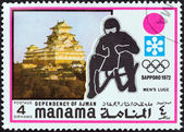 "MANAMA DEPENDENCY - CIRCA 1971: A stamp printed in United Arab Emirates from the ""1972 Winter Olympic Games - Sapporo, Japan"" issue shows Men's luge, circa 1971. — Stock Photo"