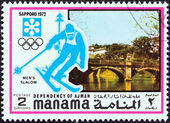 "MANAMA DEPENDENCY - CIRCA 1971: A stamp printed in United Arab Emirates from the ""1972 Winter Olympic Games - Sapporo, Japan"" issue shows Men's slalom, circa 1971. — Stock Photo"