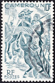 CAMEROON - CIRCA 1946: A stamp printed in France shows Lamido horsemen, circa 1946. — Foto Stock