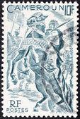 CAMEROON - CIRCA 1946: A stamp printed in France shows Lamido horsemen, circa 1946. — Zdjęcie stockowe